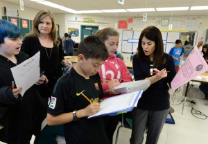 Teacher and math coach Mona Keeler, far right works with students Lauren Zorovic, 12, Jameson Chubb, 12, and Logan Utter, 12, as co-teacher Sarah DeJesus, behind, observes, during a 7th grade math class at Iron Horse Middle School in San Ramon, Calif., on Wednesday, March 4, 2015. Keeler is a teacher and math coach who tries to help students overcome math anxiety. This particular lesson dealt with proportional relationships and had students work as teams, allowed them to use calculators in order to focus on the concepts of the lessons instead of worrying about getting calculations wrong and had the students physically moving around the classroom to different stations. (Dan Honda/Bay Area News Group)